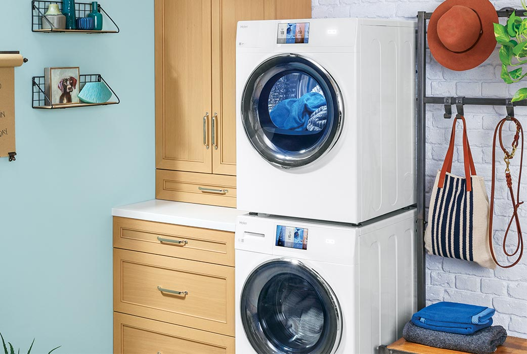 Haier front load stackable washer and dryer stacked in multi-purpose mud room