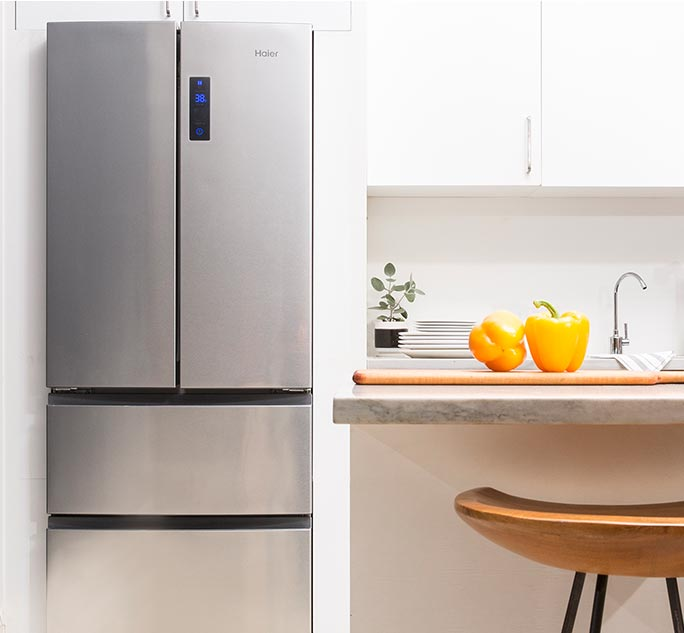 Haier french door refrigerator installed in small contemporary kitchen