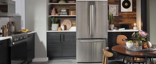 Haier stainless steel french door refrigerator in contemporary kitchen