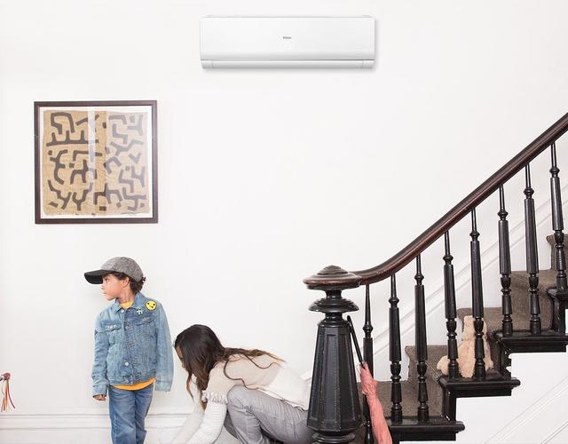Photo of a Haier ductless wall mount mini split air conditioner installed in foyer of home