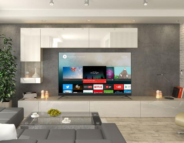 Photo of a Haier HDTV television mounted on the wall of a modern living room