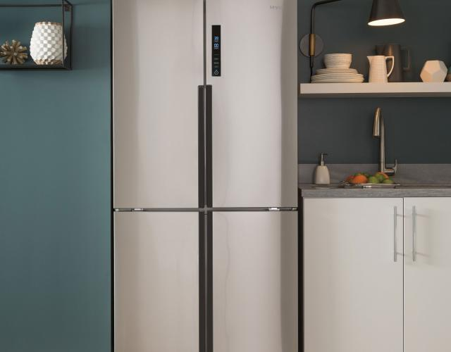 Photo Of A Haier Stainless Steel Quad Door Refrigerator Featured In A  Contemporary Green Kitchen.