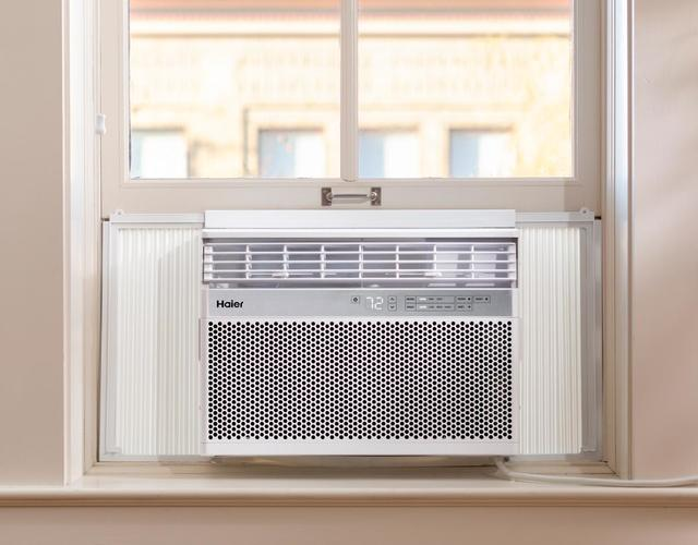 Photo of Haier window room air conditioner installed in home