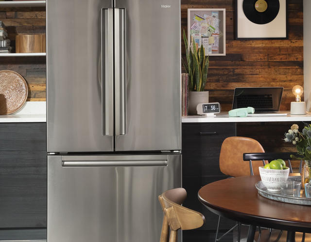 Photo of a Haier stainless steel french door refrigerator featured in a contemporary kitchen