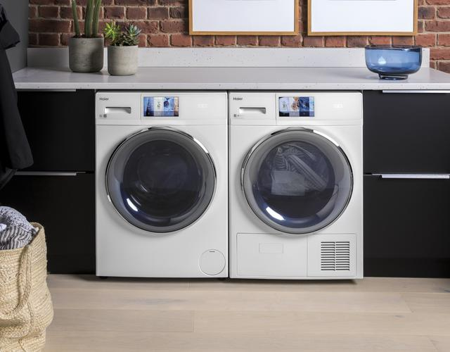 Photo of white Haier front load washer and dryer pair installed in urban home