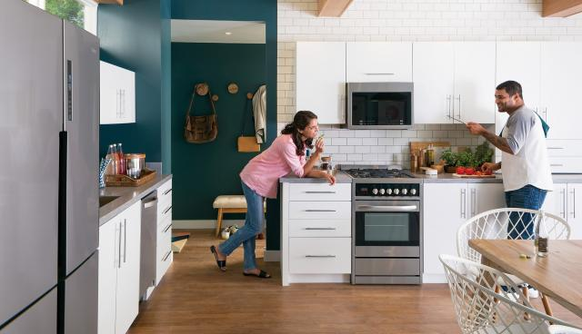 Haier Stainless Steel Kitchen Appliances Featured In A Green And White  Contemporary Kitchen