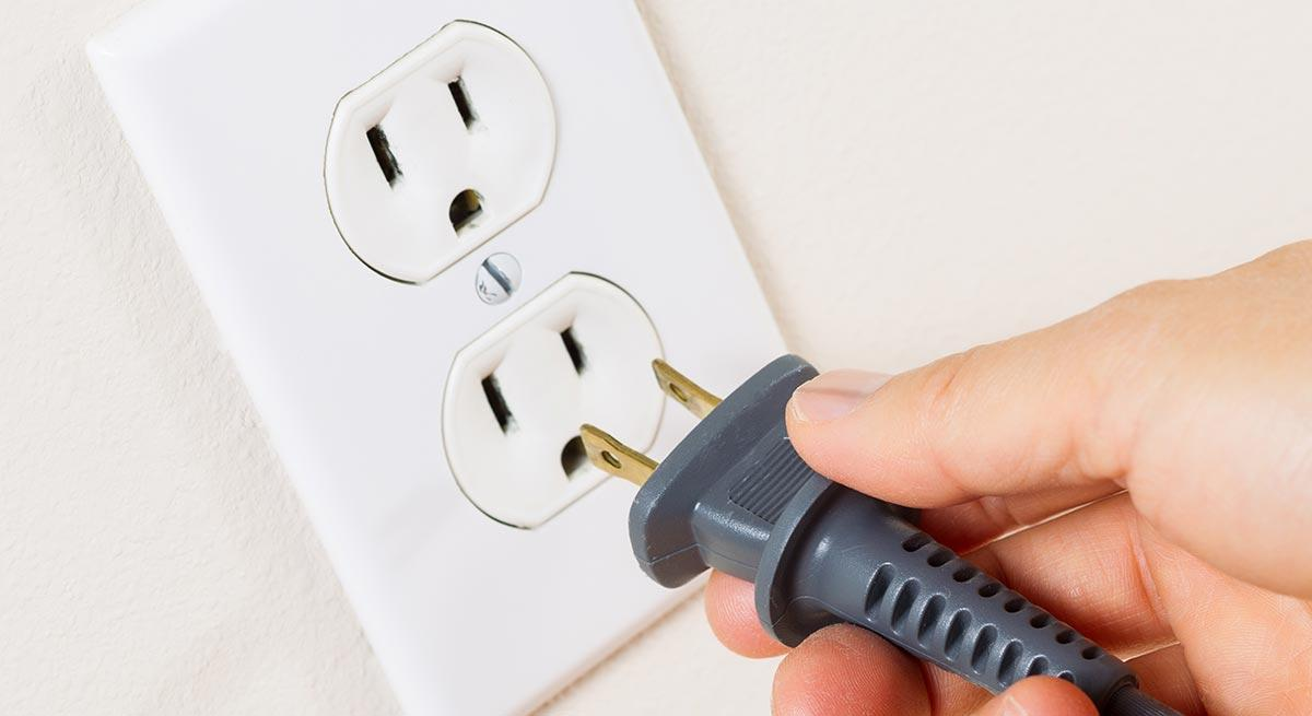 Photo of plugging unit into standard wall outlet