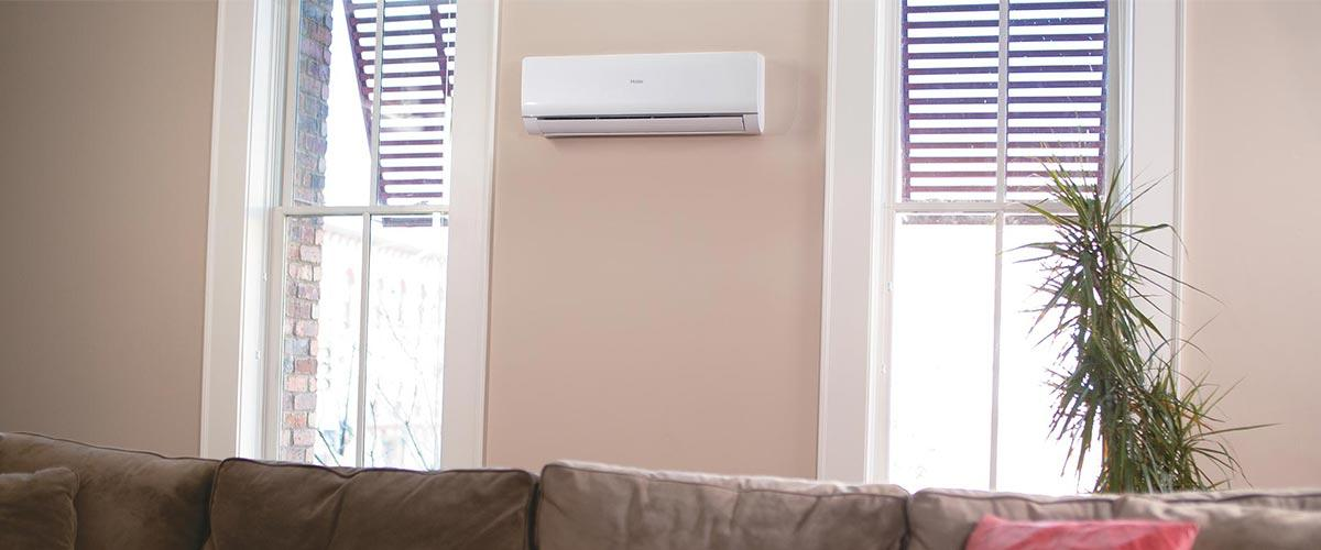 Photo of a Haier ductless wall mount mini split air conditioner installed in a living room